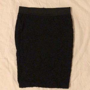 Candie's form fitting lace black skirt